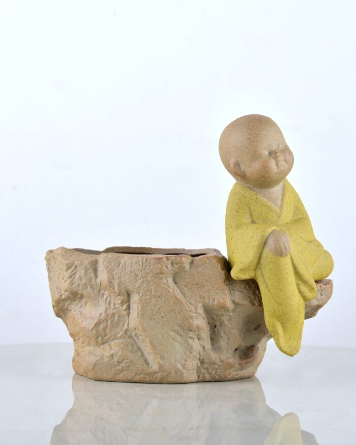 Stone shape pot with sitting monk, cute home decor online - Unlimited Greens